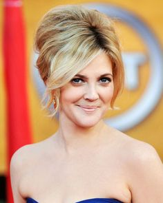 Google Image Result for http://stylecheckup.com/wp-content/uploads/2010/11/Retro-Updo-hairstyle.jpg