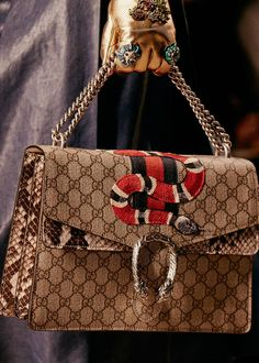The New Shape: First seen at the Spring 2016 fashion show in Milan, the season's structured bags are genteel with a modern twist. Tiger head and star studs mix with rose embroidery on Cat Lock, mismatched Web stripes detail Sylvie, and the Dionysus is crafted in panels of exotic leather or laden with beaded motifs.