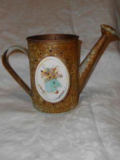 Vintage Marjolein  rustic metal watering can w ceramic insert.