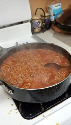 Red chile, pork meat for tamales.