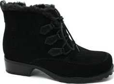 """Trotters Women's Snowflakes Boot                                 synthetic                    Manmade sole                    Shaft measures approximately 5"""" from arch                    Heel measures approximately 1 1/2""""                    Platform measures approximately 1/2""""                    Boot opening measures approximately 10"""" around                    Weatherproof"""