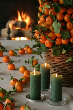 European Christmas inspriation with oranges. Get a scaled down look with oranges and Mirage LED candles in fern.