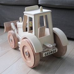 Hand made wood tractor with personalised number plate is every childs dream toy . Standing over a foot high and weighing in at eight kilos it will become a role play favorite. Made in our north Yorkshire workshop to special order from a mix of quality ply and hardwood with strong metal