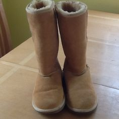 Authentic UGG Boots Authentic UGG boots discontinued color-sunflower in great condition except near the top Jean dye other than that great shape!! UGG Shoes