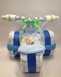 Champion Tricycle Diaper Cake http://babyfavorsandgifts.com/champion-tricycle-diaper-cake-p-285.html