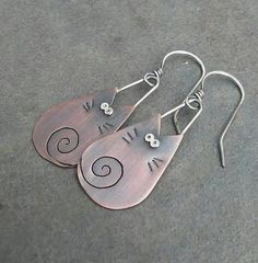 This adorable pair of kitty earrings is handmade by me using sterling silver and copper. They measure 2 1/8 inches in length from the top of the ear wire to the bottom of the dangle. They have been oxidized to show detail and add rustic charm.