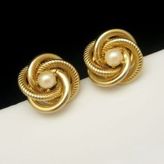 ELEGANT AND TIMELESS VINTAGE LOVE KNOT EARRINGS! Twined love knots in shiny and textured gold plated metal with lovely faux pearls. $34.95. From http://stores.ebay.com/My-Classic-Jewelry-Shop
