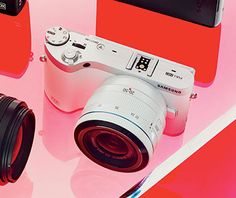 Samsung NX300. 20.3 megapixels, hybrid autofocus for quick, detailed shots, ability to capture 8.6 snaps per second, tilting screen for tricky angles, built-in Wi-Fi for easy uploading to Flickr or Facebook. From $749, samsung.com.