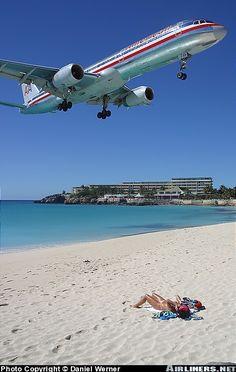 A 757 over Maho Beach om the Caribbean island of St. Martin. ASPEN CREEK TRAVEL - karen@aspencreektravel.com