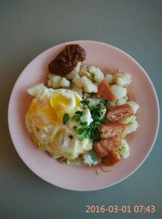 Singapore: fried radish cake (chai tau kway) with fried egg and, canned luncheon meat.