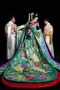 The courtesans of Edo Japan has some of the most splendid and ornate kimonos: this example would be an expensive and high-craft contemporary one created presumably only for show use in a valiant effort to conjure up times that no longer exist.