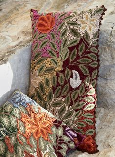 Our artisan-made pillows are lush with folkloric blooms in soft, vegetal dyed wool. Hand-embroidery and picot crochet define each leaf and petal. Woven cotton back with zipper.