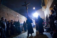 Penitents of the Cristo Negro (Black Christ)  Brotherhood of Cáceres walk the streets at night during their Holy Week procession in Cáceres, Spain. Semana Santa 2014. (Picture: Pedro Armestre/AFP/Getty Images)