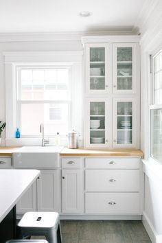 Behind the Scenes: Our Kitchen Reno | A Couple Cooks I love the white cabinets, black center island, and butcher block counters.