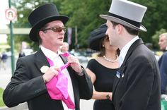 Royal Ascot fashion police ask a man to remove his cravat before going on to the course yesterday.