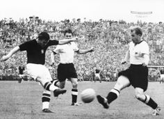 Hungary's Galloping Major, the great Ferenc Puskas (left), lashes a shot at goal during the 1954 World Cup final