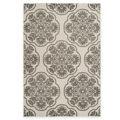 Comes in a navy and a light blue  Safavieh Cottage Medallion Indoor/Outdoor Rug - BedBathandBeyond.com