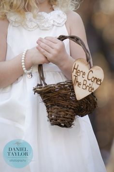 "A sweet DIY ""Here Comes the Bride"" sign on the flower girl's basket. Daniel Taylor Photography"