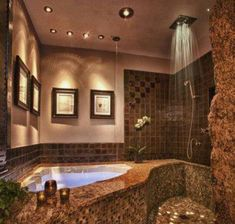Jacuzzi tub and rain shower complete this amazing bathroom design.  It's like you have your very own private getaway!