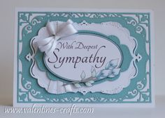 handmade sympathy card ...  soft blue and white ... lovely layers of die cut labels ... luv the background panel die cut ...  pierching ... great card!!