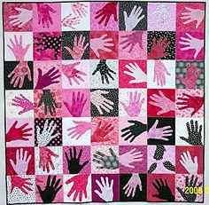 This is a great idea, take the handprints of family and incorporate them into a quilt.  Would make a great gift.  Not loving the colors of this quilt, but that is an easy fix.