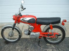 My first motorcycle, the super stylish and powerful Honda Super 90!  ;-)