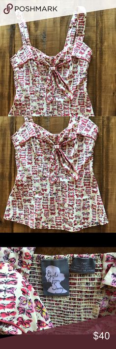 Anthropologie retro peplum butterfly tank Adorable butterfly tank top with retro peplum - can be worn as tank or halter. From anthropologie. Gently worn. Anthropologie Tops Tank Tops