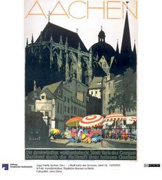Aachen. Die ( ... ) Stadt Karls des Grossen     Plakat      Jupp Wiertz (5.11.1888 - 2.1939), Entwerfer     J. P. Biner (Nachweiszeit: 1930), Drucker     vor 1928     Druckort: Aachen      Material: Druckfarbe (gelb) & Druckfarbe (orange) & Druckfarbe (rosa) & Druckfarbe (pink) & Druckfarbe (hellblau) & Druckfarbe (braun) & Druckfarbe (hellgrau) & Druckfarbe (dunkelgrau) & Druckfarbe (schwarz) & Papier, Technik: Lithographie     Höhe x Breite: 96,5 x 68,2      Ident.Nr. 14050565