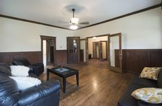 The living room opens to the foyer and stairwell Stone Mansion, Washington Street, Renting A House, Foyer, Mansions, Living Room, Furniture, Home Decor, Decoration Home