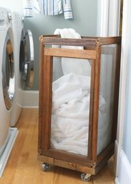 laundry hamper made out of screens and a 4 wheel dollie - Olde Green Cupboard Designs