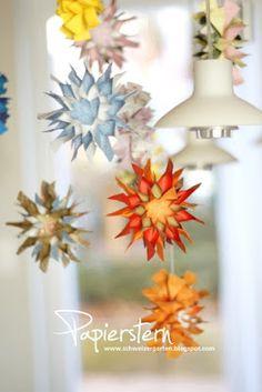 colorful paper star mobile # 10 - Garden and Home Design Mobiles, Star Mobile, Christmas Crafts, Xmas, Paper Stars, Handmade Ornaments, Bunt, Garden Landscaping, Handarbeit