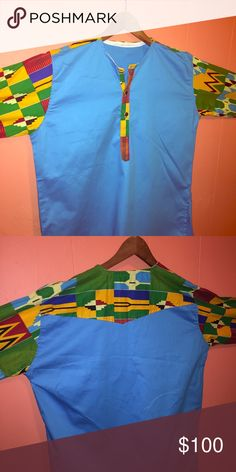 African print Dashiki Unisex African dashiki. Can be worn like a dress or with pants. Brand new! Tops Button Down Shirts