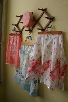 LOVE the idea of using vintage kitchen aprons for kitchen decor.