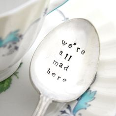We're All Mad Here, vintage stamped tea spoon for your Mad Hatter's Tea Party. Alice in Wonderland quote by milkandhoneyluxuries, MTO. $20.00, via Etsy.