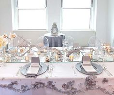 Menus printed on glitter paper, votive candles and a mirrored table runner shimmer at the morning reception.