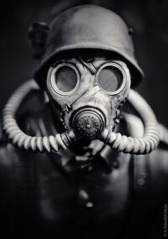 WWII German Soldier in A Gas Mask. Hitler should be given credit for seeing that gas was not used during the European war due to his own disgust with chemical warfare. He had been a gas casualty during the First World War. Gas Mask Art, Masks Art, Gas Masks, Gas Mask Drawing, Drawing Art, Sucker Punch, Black And White Face, War Photography, Photography Ideas