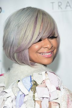Raven-Symoné Consider this new hair trend the lighter, trendier cousin of the beloved rainbow hair that took over everyone's Instagram. It's a blend of pearl and light pinks, blues, purples, or greens. Raven-Symoné's style has subtle hints of blue, purple and green, which she compliments perfectly with purple eyeshadow.   - Redbook.com