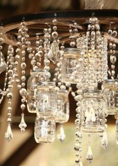 We cannot get over this amazingly beautiful mason jar chandelier by Mershon Events.