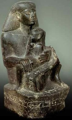 Statue of Senenmut with Neferure Material: Black Granite Size: Height: 60 cm Location: Karnak, Temple of Amun-Re, Courtyard of the Cachette Excavation: G. Legrain's Excavations of 1904 Period: 18th Dynasty, Reign of Hatshepsut (1473-1458 BC)