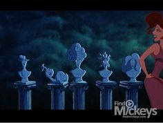 In this scene from Hercules when Meg is singing that she loves Hercules, the backup goddess singers are in the formation of the Haunted Mansion Concrete Heads that appear towards the end of the ride.
