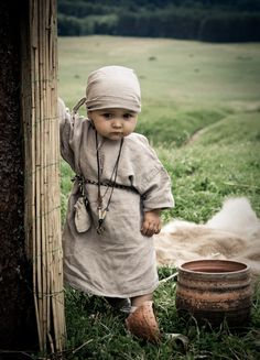 Little girl in ancient crafts festival in Kernave, Lithuania by Tomas Mykolaitis