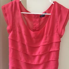 AE salmon pink shirt Super sheer and super cute. Layers all over, including on the sleeves. See-through sheer. Buttons on the back toward the top. Runs big, would fit a large. American Eagle Outfitters Tops Blouses