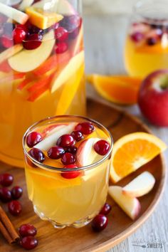 Apple Cider Sangria - This Apple Cider Sangria is filled with white wine, apple cider, apple brandy, apples, oranges and cranberries. A fun and festive drink for all your holiday gatherings.