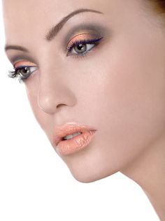 Complimentary colors- orange eye shadow and blue liner