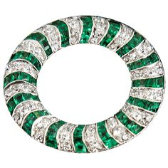 1920s French emerald and diamond open circle brooch. Platinum and yellow gold mounted,open circle brooch set old cut diamonds and shaped emeralds,French ,c,1920