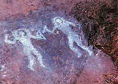This cave painting from 10,000 BC is from Val Camonica, Italy.  It appears to depict two beings in protective suits holding strange implements.