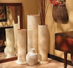 Almost any room can benefit from a few large, impressive accent pieces, but home accessories like these tend to be expensive. These inexpensive columns are made from building forms - or the tubes used to roll carpets - plus terracotta flowerpots and saucers. You can use a jigsaw to cut the tubes shorter if desired. http://www.home-dzine.co.za/decorating/decorating-column.htm