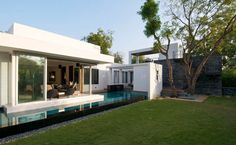 Here is a home showcasing a faultless modern design. Dinesh Mills Bungalow comes from atelier dnD (we noticed their site is having some problems right now, but be sure to check back in a few days) and is located just outside the city of Vadodara, India.