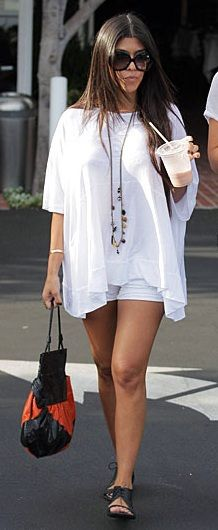 Kourtney Kardashian Workin' The Boho Look By Wearing A Flowy, White Shirt: Tiny, White Shorts: And Black, Laced Sandals! Cute And Stylish!
