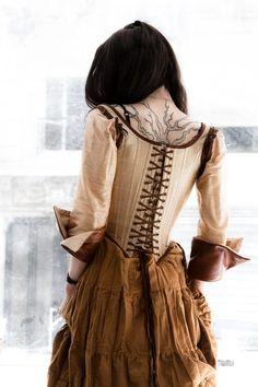 I adore this corset / tattoo combo
